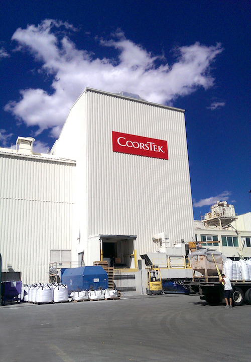 Photo of the CoorsTek 9th Street facility with a CoorsTek sign on the side of the building.