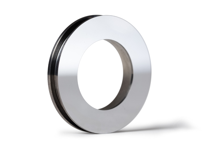 Silicon nitride hard face seal for automotive applications.