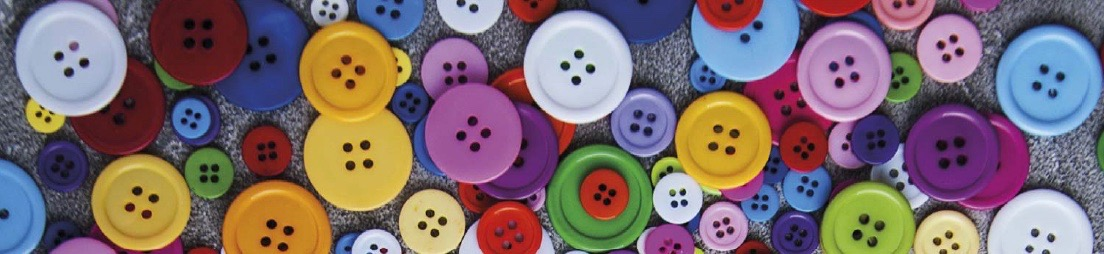 Photo of various buttons for clothes with different sizes and colors.